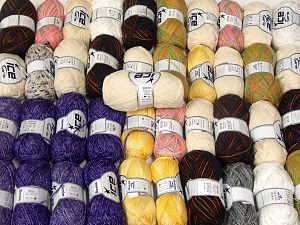Fancy Yarns This mixed lot includes a total of 2000 gr (70.5 oz.) yarn. There is no standard for ball weight. Also disregard any information on the labels. You will get what you see in the photo. Brand Ice Yarns, fnt2-66244